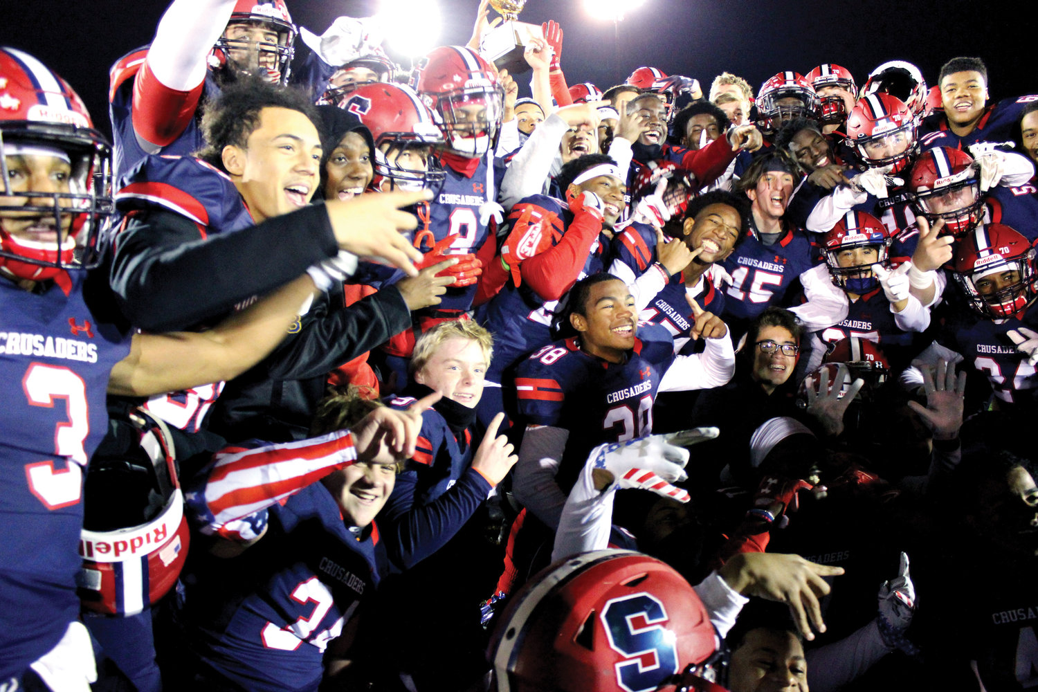 Archbishop Stepinac players celebrate winning the Catholic High School Football League of Metropolitan New York AAA League championship with a 29-18 victory over Cardinal Hayes at Mitchel Athletic Complex in Uniondale Nov. 17.