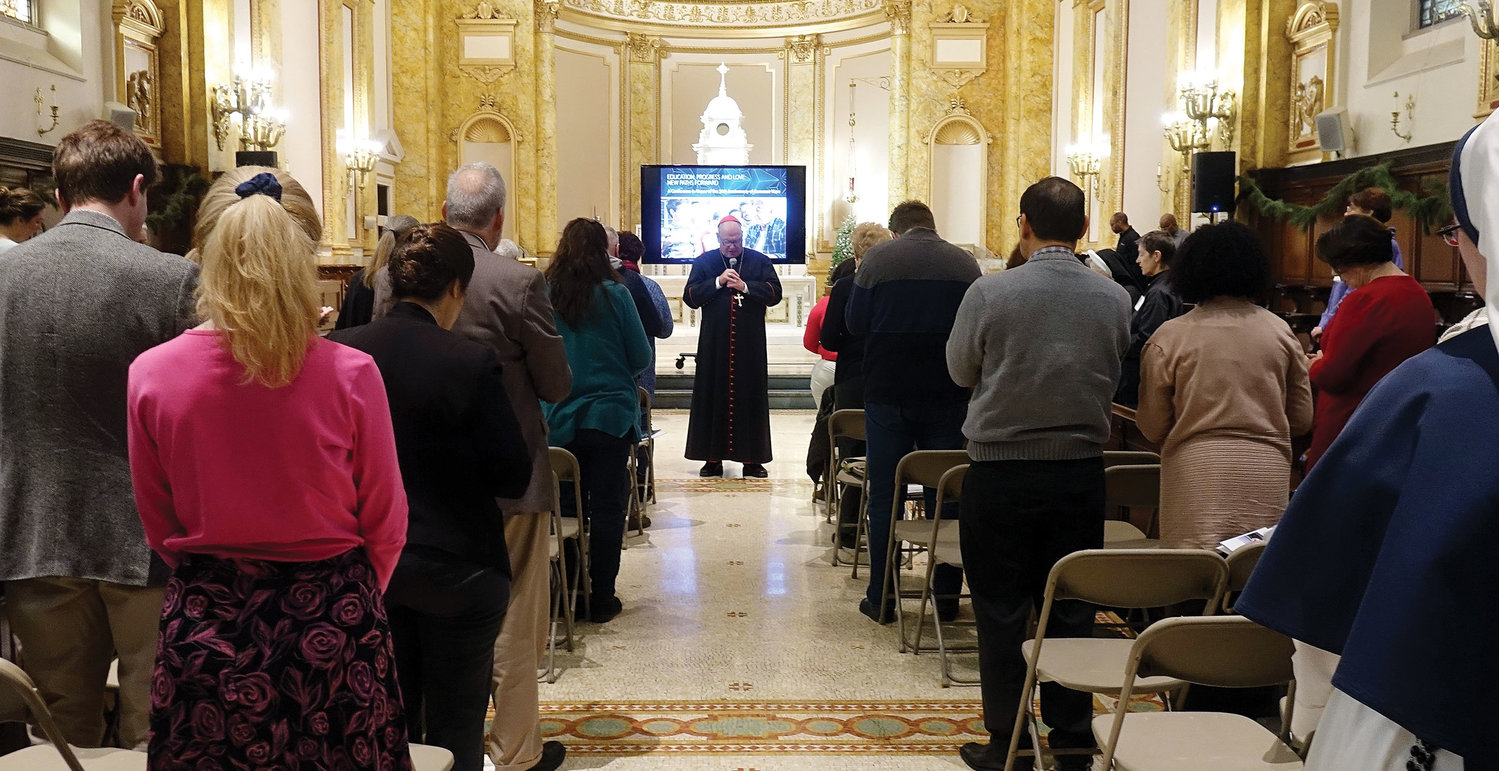 Cardinal Dolan leads conference participants in the Angelus in the seminary chapel.