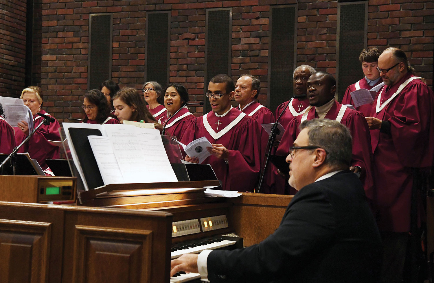 Gusti Daija, music director, leads the choir at the organ during the Mass.