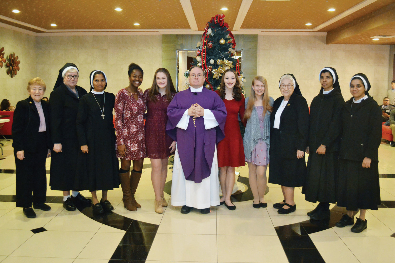 The new officers of the Pallottine Teenage Federation join the Pallottine Sisters and Father Michael Martine, center, at the 57th annual PTAF conference at Honor's Haven Resort & Spa in Ellenville. They are, from left, Sister Carmel Therese Favazzo, C.S.A.C.; Sister Patricia Gatti, C.S.A.C.; Sister Roseline Jayaraj, C.S.A.C.; Orlean Dubreus, PTAF secretary; Amanda Molloy, PTAF vice president; Father Martine; Veronica Keene, PTAF president; Courtney Nazak, PTAF program chairperson; Sister Ann Joachim, C.S.A.C.; Sister Smija Peter, C.S.A.C.; Sister Laveena Bennis, C.S.A.C.
