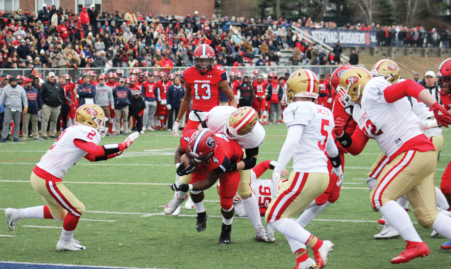 Malik Grant carried the ball for some of his game-high 124 rushing yards. Soon after the win, the senior running back was one of nine Crusaders to earn all-league honors from the Catholic High School Football League of Metropolitan New York.