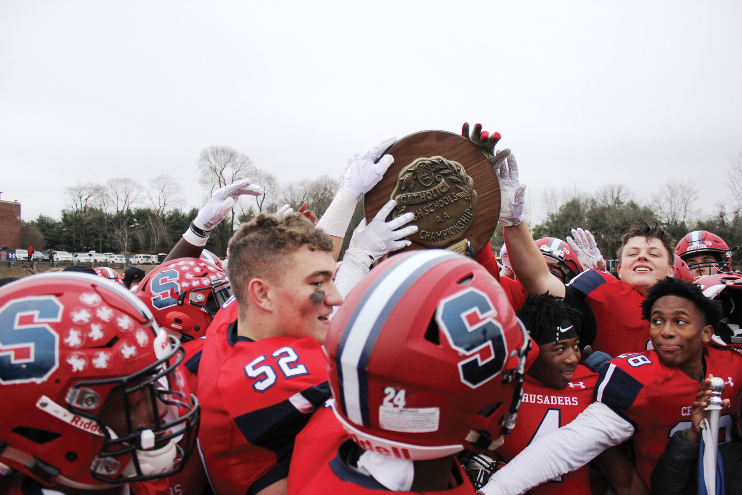 Archbishop Stepinac players celebrate winning a second consecutive Catholic high school state football title and third in four years with a 49-7 victory over St. Francis of Athol Springs, in a game in White Plains Nov. 24.