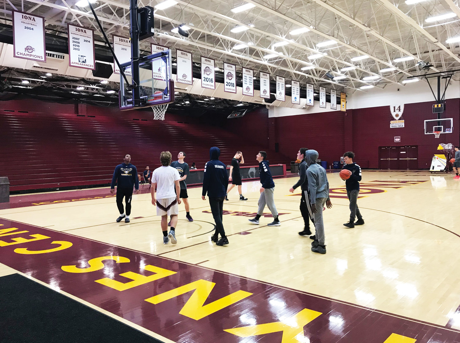 Our Lady of Lourdes High School boys basketball team participates in a shootaround at Iona College in New Rochelle after working on a community service project to convert an 18th-century Quaker church into a two-family home in Chappaqua Dec. 1.