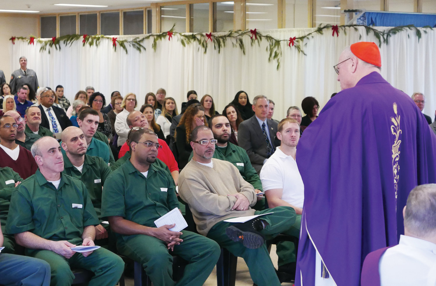 Cardinal Dolan speaks during a Mass for Christmas he celebrated for 60 inmates and staff members at Ulster Correctional Facility, a medium-security state prison housing 660 men in Napanoch Dec. 17. Twenty percent, or 131, of the inmates are Catholic.