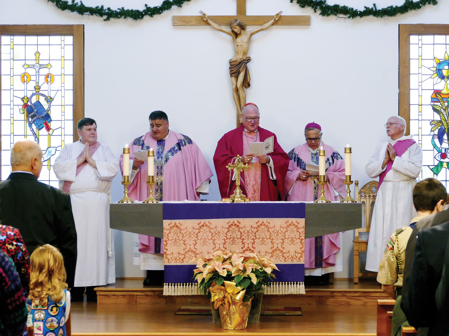 Cardinal Dolan, center, celebrates Mass to mark the 50th anniversary of Holy Cross Church in Middletown Dec. 15. Joining the cardinal on the altar are, from left, Edmund Lazzari, a candidate for the permanent diaconate; Father Michael Cedro, pastor of Holy Cross; Auxiliary Bishop Dominick Lagonegro; and Deacon Barney Kahn.