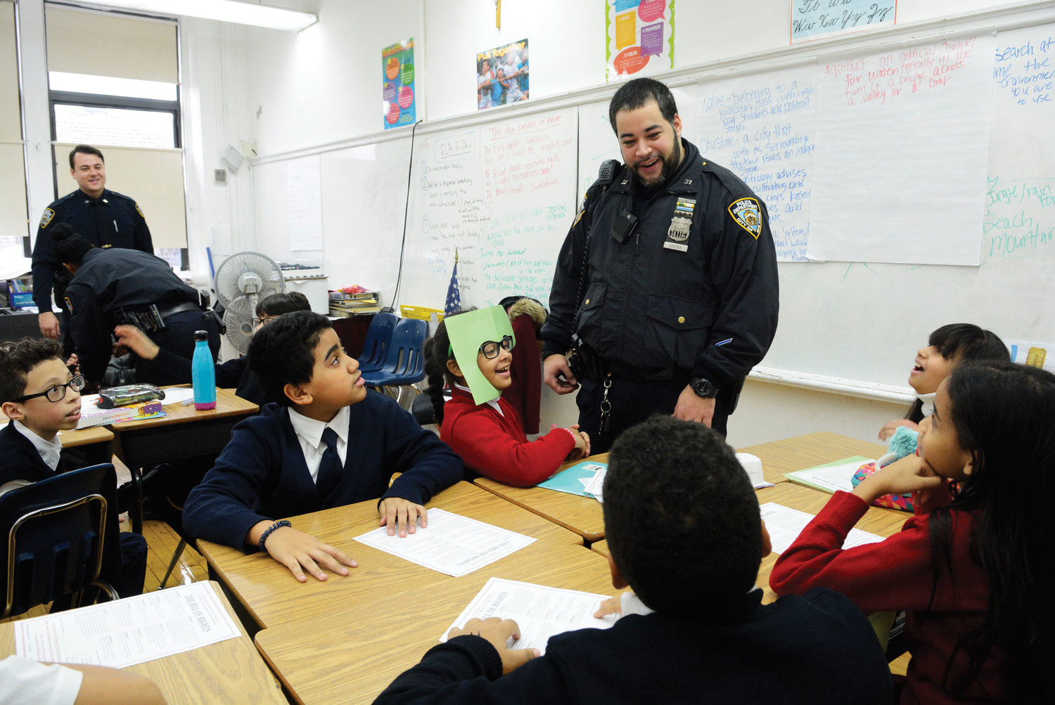 Ariel Urena, a NYPD officer in Manhattan's 33rd precinct, speaks with students.