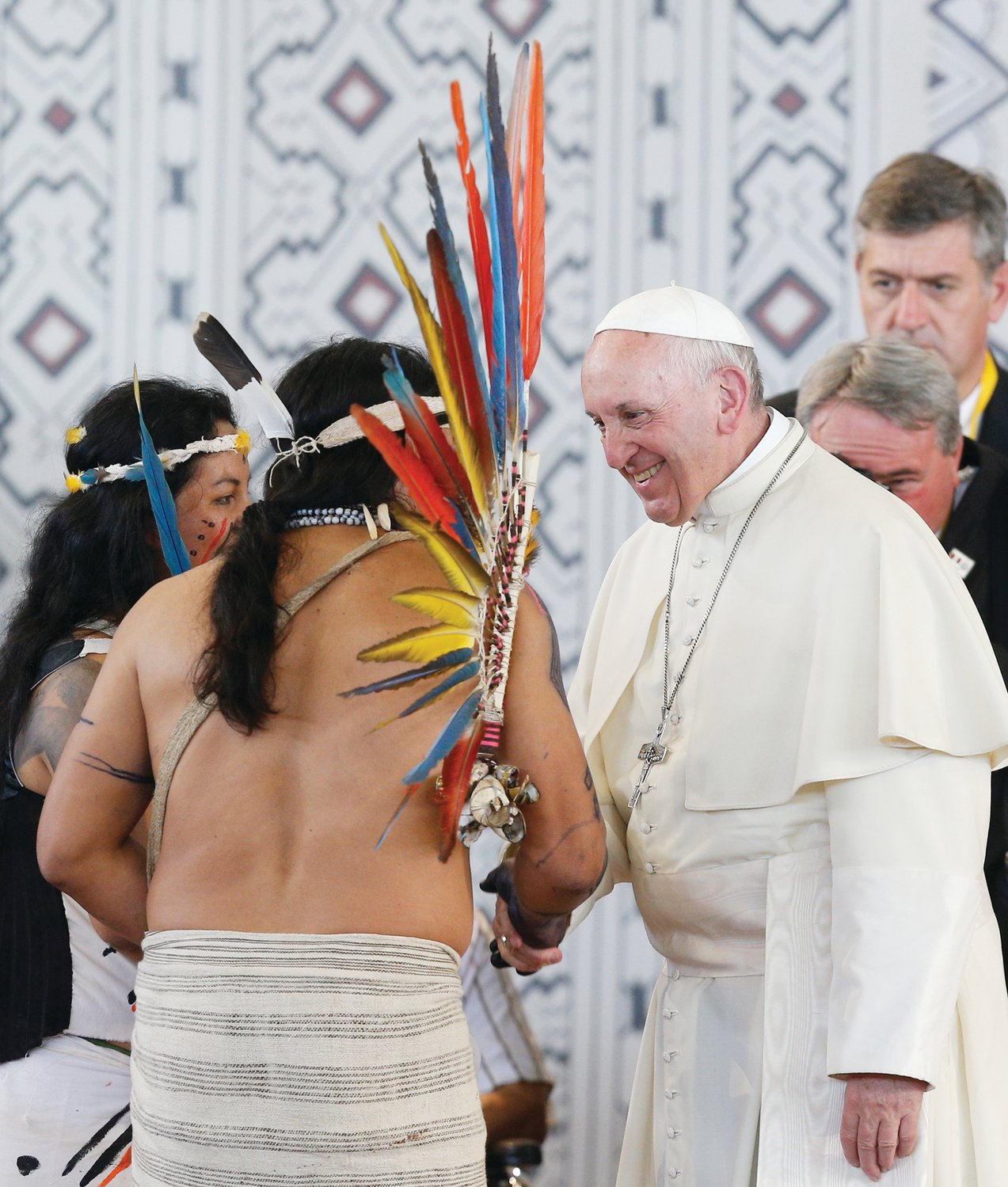 POPE IN PERU—Pope Francis greets members of an indigenous group from the Amazon region during a Jan. 19 meeting at Madre de Dios Stadium in Puerto Maldonado, Peru.