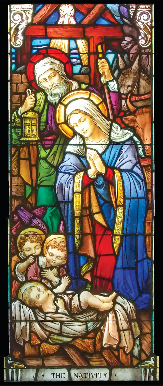 THE NATIVITY—A stained glass window depicting the Holy Family graces St. Aedan Church in Pearl River. The Christ Child gazes tenderly at his parents, St. Joseph and the Blessed Virgin Mary. The Nativity is one of 25 stained glass windows at St. Aedan's depicting the life of the Blessed Mother. From 1904 to 1985 the windows enhanced the chapel of the now-closed Ladycliff College in Highland Falls.