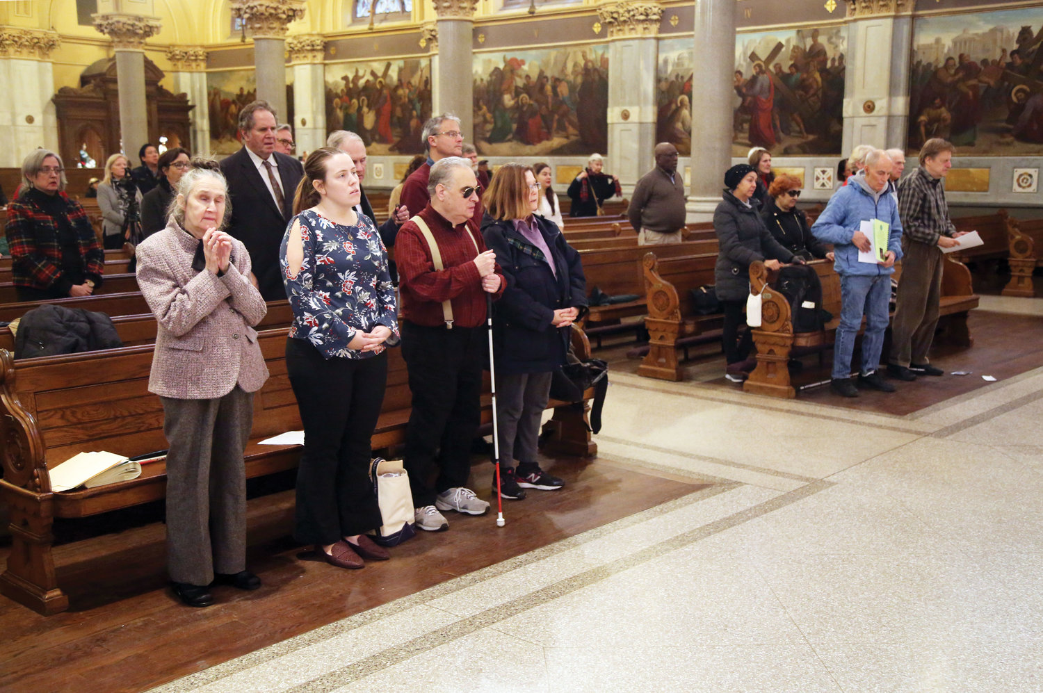 Congregants participate in the Mass.
