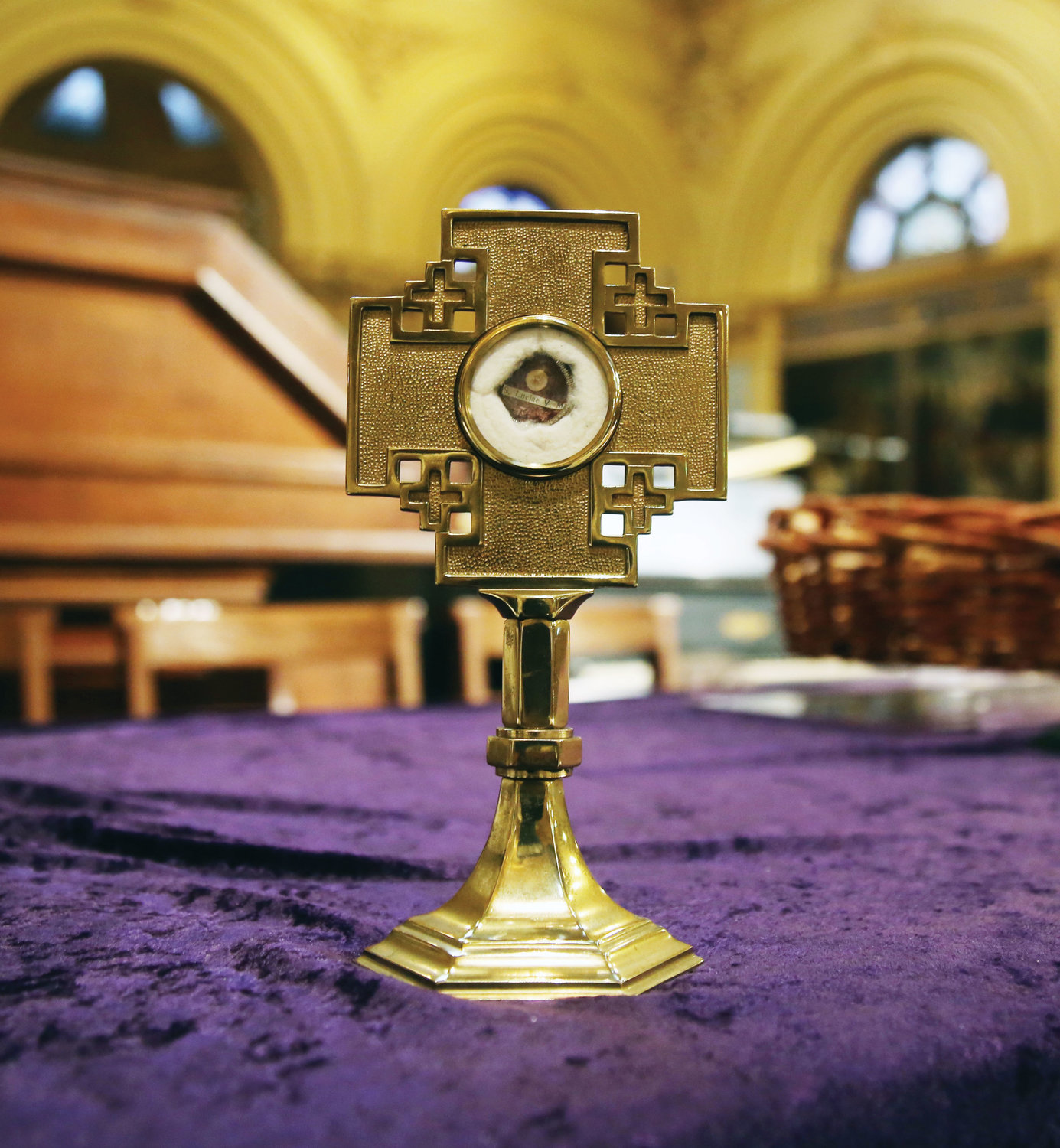 A relic of St. Lucy was venerated by the congregation.