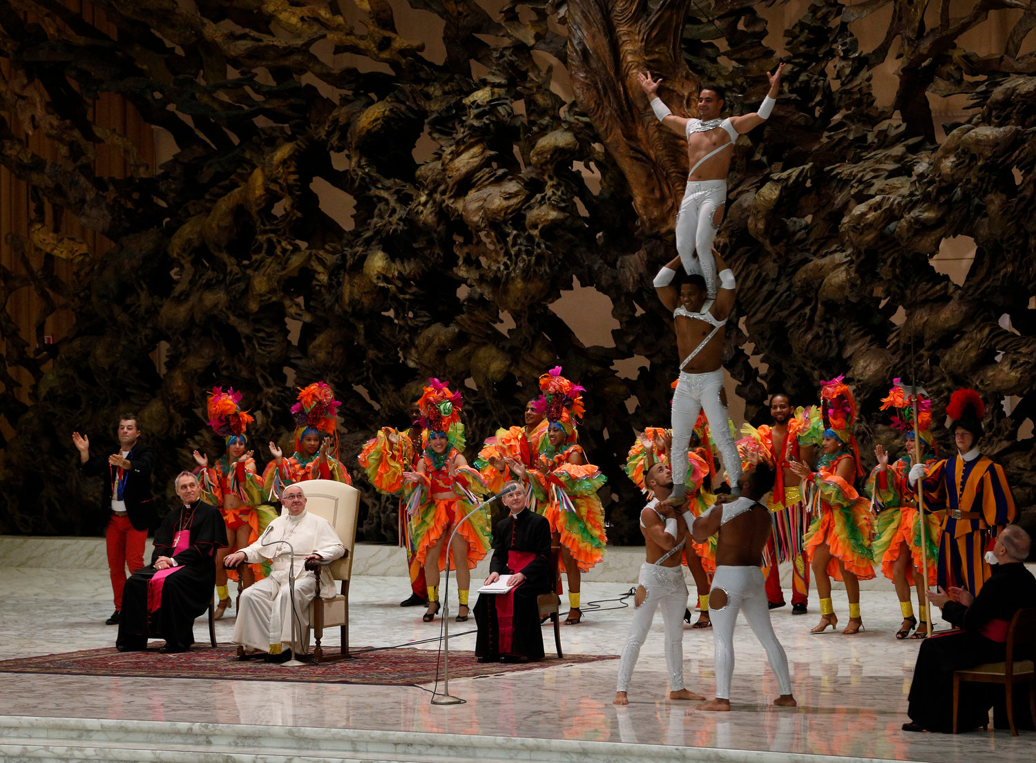 Pope Francis watches as members of CirCuba, the Cuban national circus, perform during his general audience in Paul VI hall at the Vatican Jan. 2.