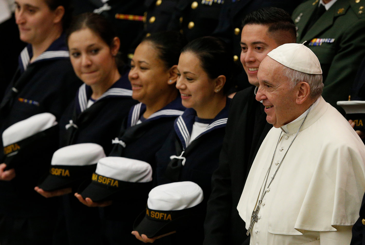 Pope Francis poses with sailors during his general audience in Paul VI hall at the Vatican Jan. 2.