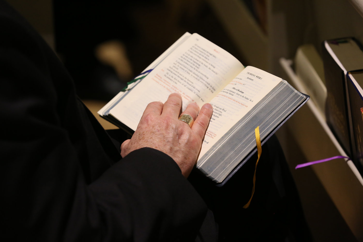 A bishop holds a prayer book during a service in the Chapel of the Immaculate Conception at Mundelein Seminary Jan. 2 at the University of St. Mary of the Lake in Illinois, near Chicago.