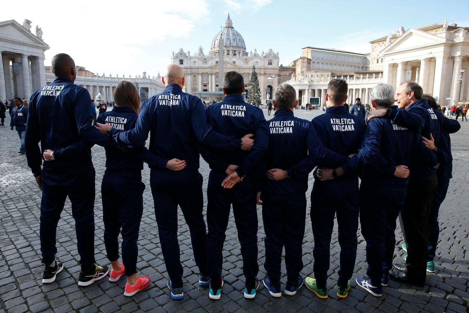 Members of the new Vatican sports team pose during a photo opportunity outside St. Peter's Square at the Vatican Jan. 10.