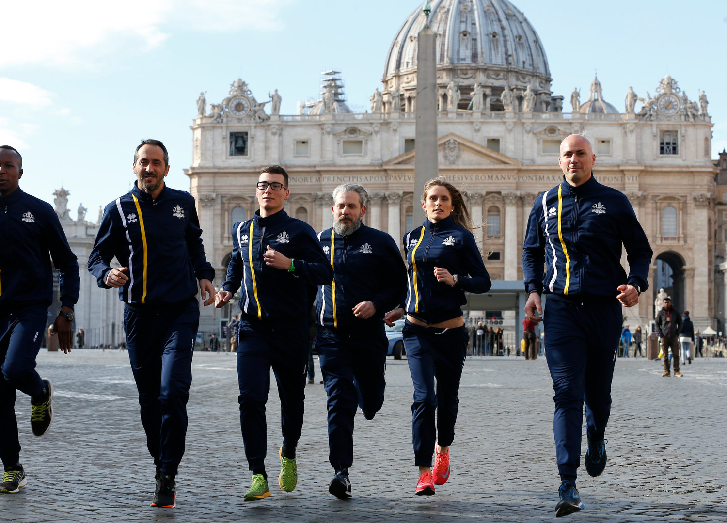 Members of the new Vatican Athletic sports association run during a photo opportunity outside St. Peter's Square at the Vatican Jan. 10.