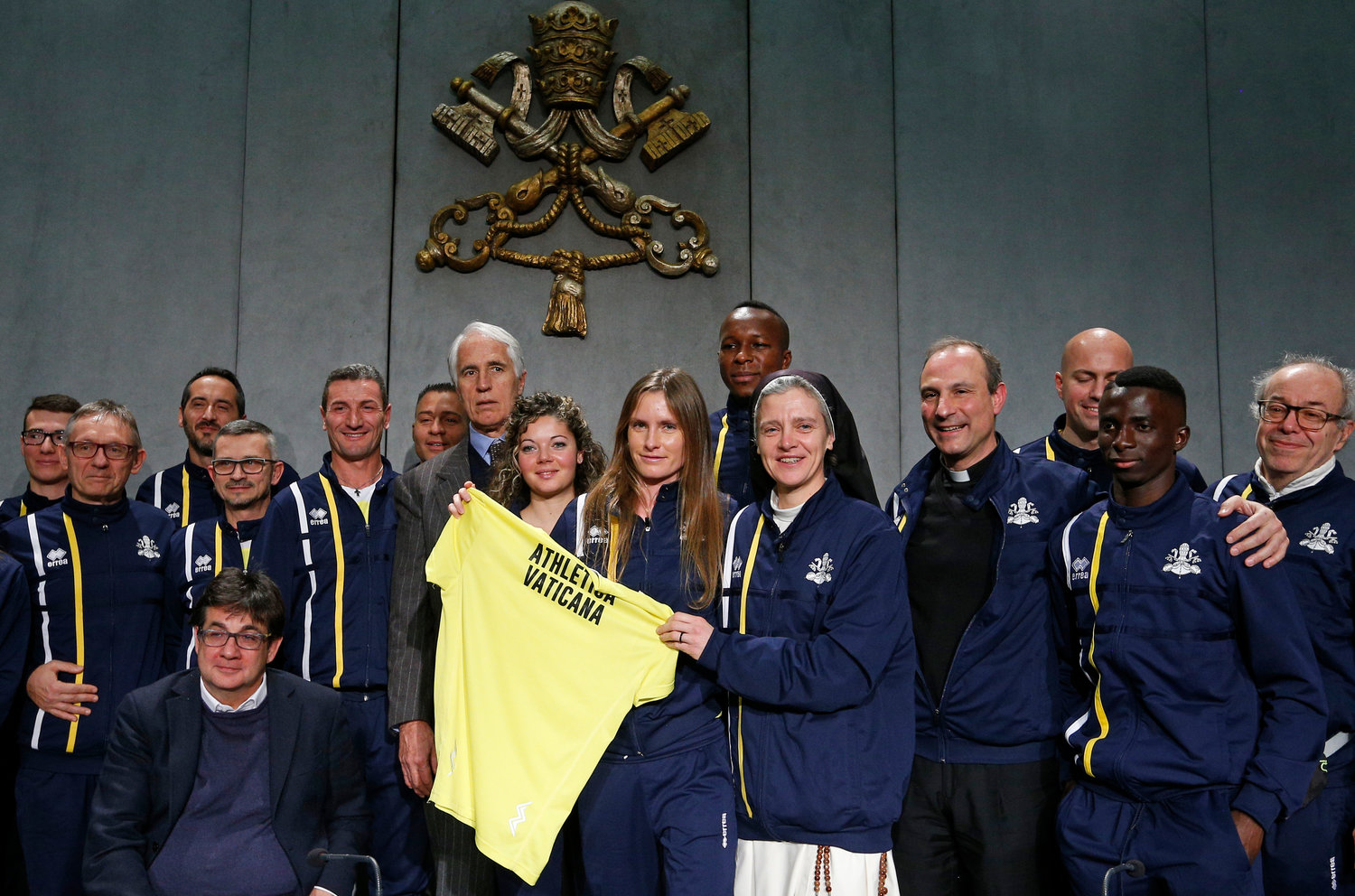 Members of the new Vatican Athletic sports association pose for a photo after a news conference at the Vatican Jan. 10. The Vatican announced the formation of the association, which includes athletes who work at the Vatican.