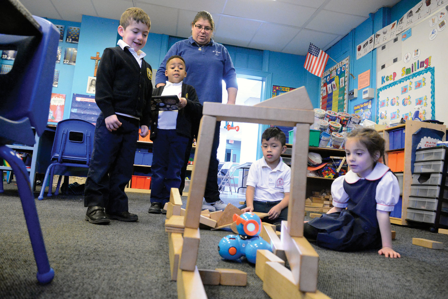 Liam Robinson, second from left, works the iPad to lead Dash the robot through an obstacle course as Charles Boyer, teacher Danielle Cavone, Chris Duchitanga and Madelyn Venuti watch during kindergarten class at Our Lady of Mount Carmel School in Elmsford Jan. 8.