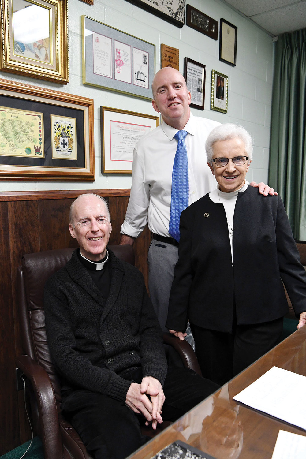Principal Vincent Sadowski joins Msgr. Jeffrey P. Conway, pastor of St. Patrick's parish, and Sister Mary Ferro, S.S.D., a former longtime principal.