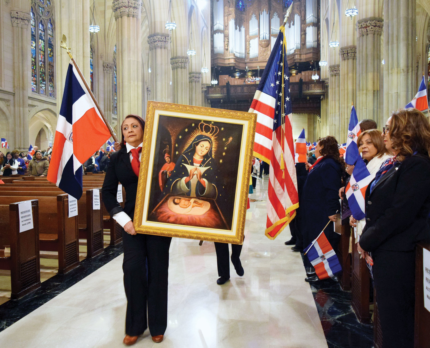 Archbishop Francisco Ozoria Acosta, of the Archdiocese of Santo Domingo, celebrated the annual Our Lady of Altagracia Mass Jan. 13 at St. Patrick's Cathedral. An image of Our Lady of Altagracia, above, is carried during the entrance procession.