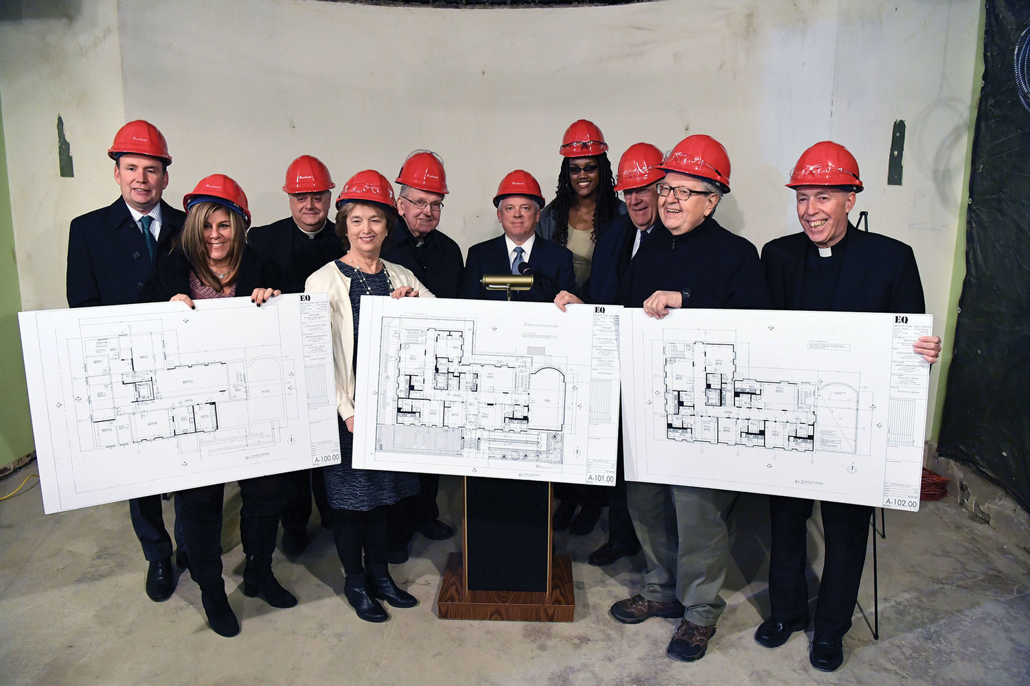 Guests hold up floor plans for ArchCare at St. Teresa. Standing from left are State Assemblyman Michael Cusick; Kim Marselle, a representative from State Senator Andrew Lanza's office; Father Joseph LaMorte, vicar general and chancellor of the archdiocese; Kate Rooney, ArchCare board member; Msgr. Peter Finn, dean for Staten Island; Scott LaRue, president and CEO of ArchCare; Yvette Fall, a representative from U.S. Rep. Max Rose's office; Thomas Alberto, ArchCare board member; and Msgr. William Belford, pastor of St. Teresa parish.