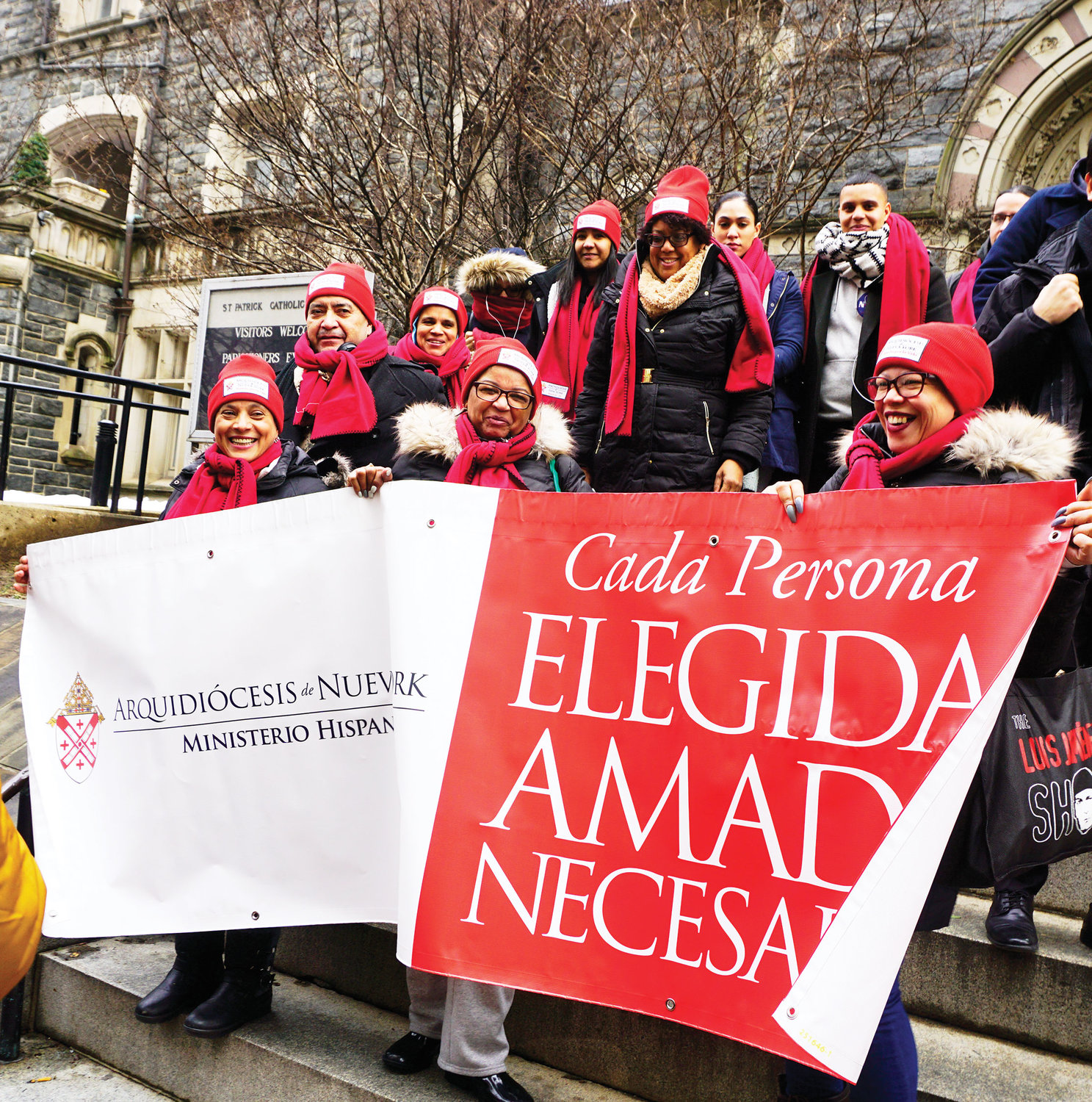 Members of the Hispanic Ministry office pilgrimage group, above, display a banner that reads Cada Persona: Elegida, Amada, Necesaria (Every Person: Chosen, Loved, Necessary).