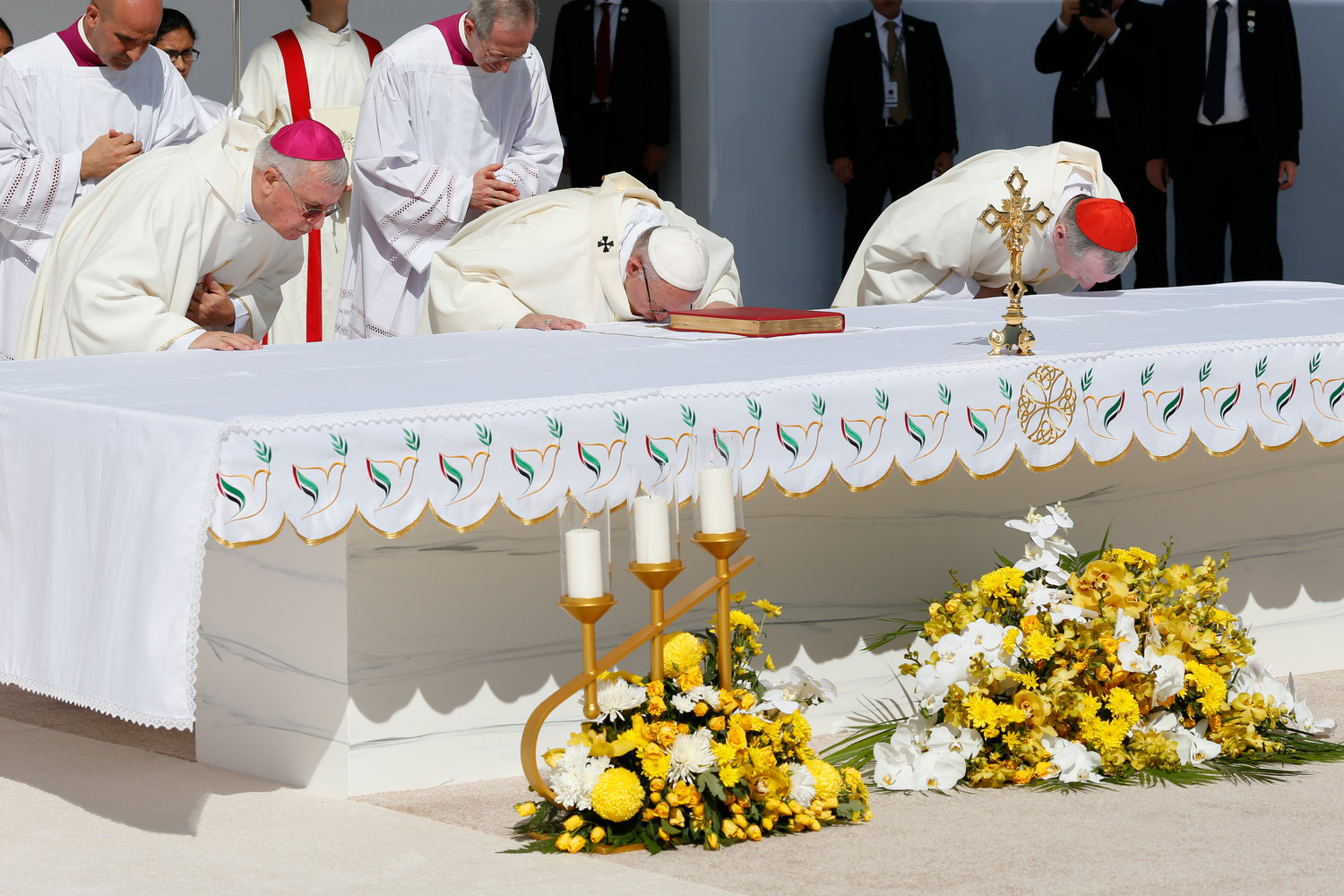 Pope Francis kisses the altar as he celebrates Mass at Zayed Sports City Stadium in Abu Dhabi, United Arab Emirates, Feb. 5.