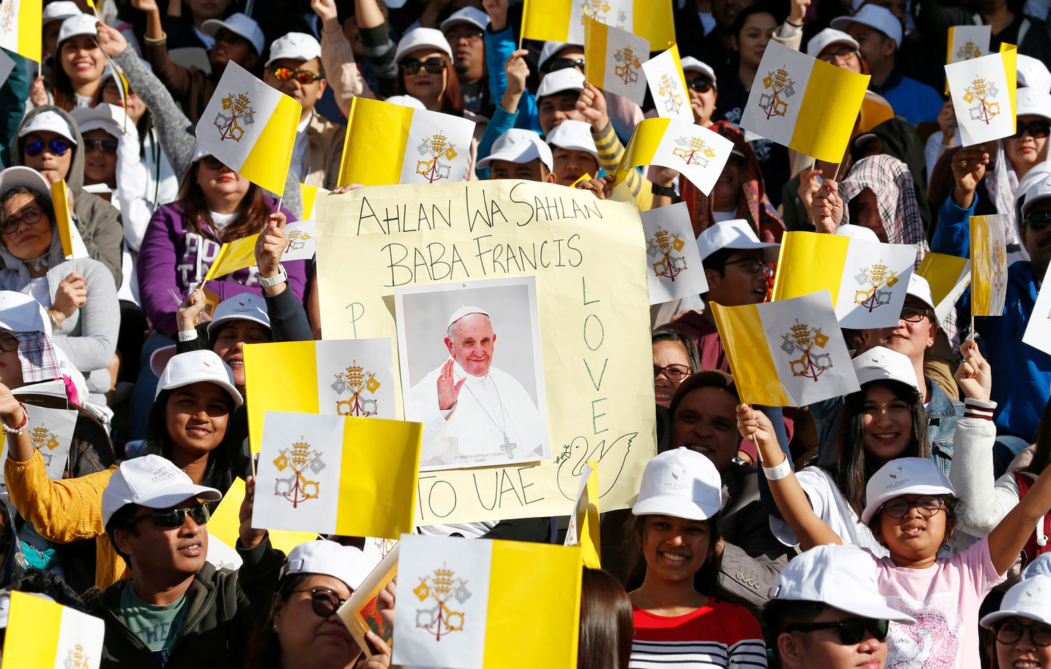 People wait for Pope Francis' arrival to celebrate Mass at Zayed Sports City Stadium in Abu Dhabi, United Arab Emirates, Feb. 5.