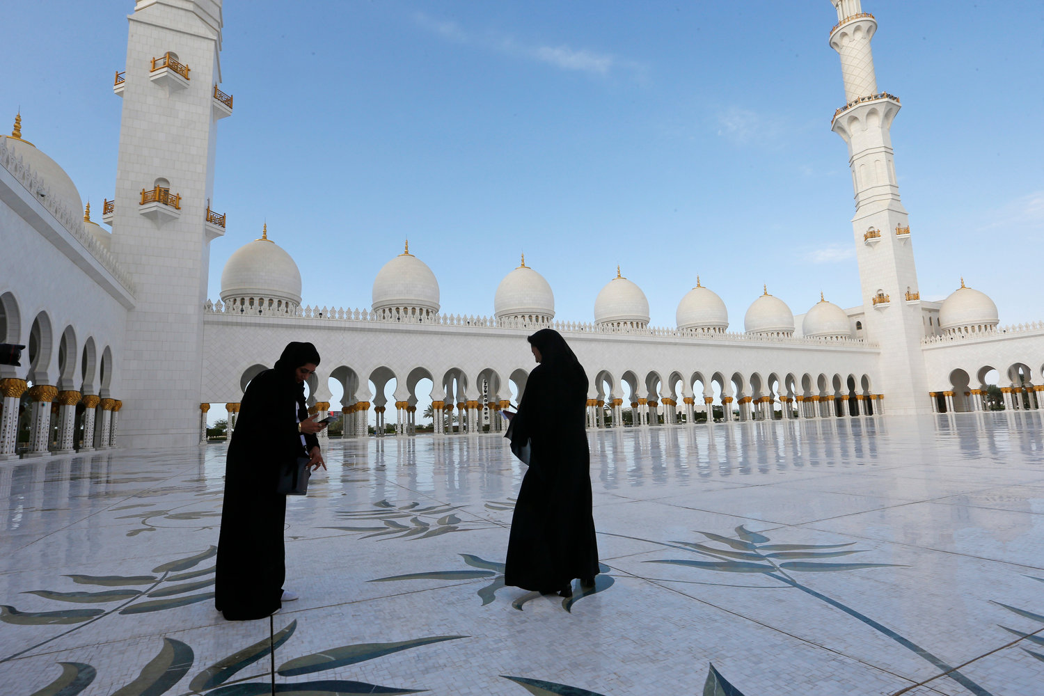 Women are pictured at the Sheik Zayed Grand Mosque in Abu Dhabi, United Arab Emirates, Feb. 4.