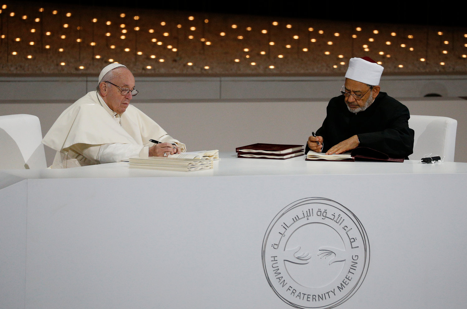 Pope Francis and Sheik Ahmad el-Tayeb, grand imam of Egypt's al-Azhar mosque and university, sign documents during an interreligious meeting at the Founder's Memorial in Abu Dhabi, United Arab Emirates, Feb. 4.