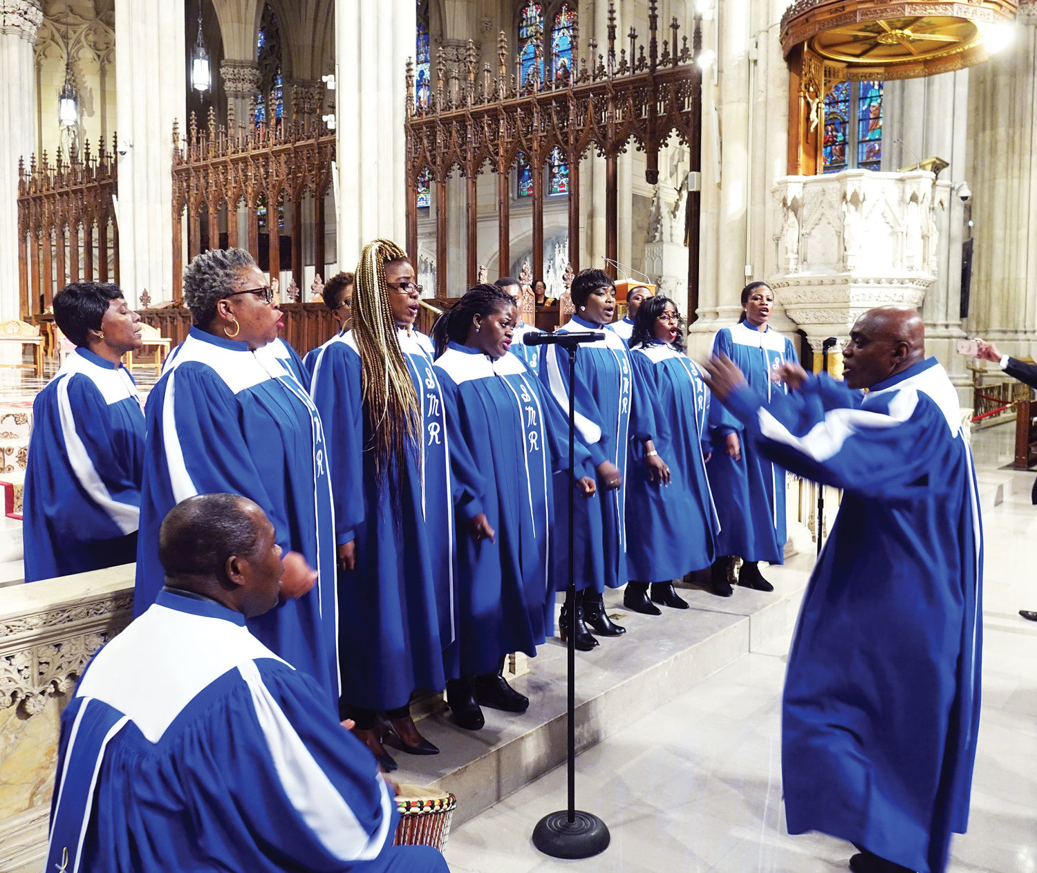 Members of the Chorale Sainte Marie choir from Notre Dame parish in Manhattan, sing during the Mass, under the direction of Sylvestre Kouadio.