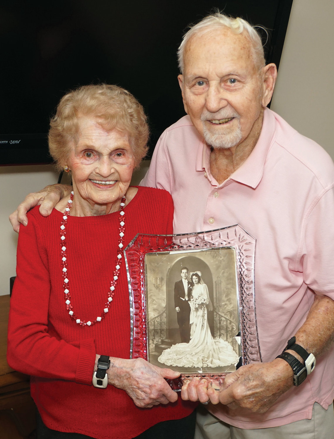 HAPPY COUPLE—Josie Maciocha, left, and her husband, Stanley, hold a treasured photo from their wedding day of Jan. 24, 1943. The parishioners of Transfiguration in Tarrytown are the longest-married couple in the archdiocese following an annual search by the archdiocesan Family Life Office.