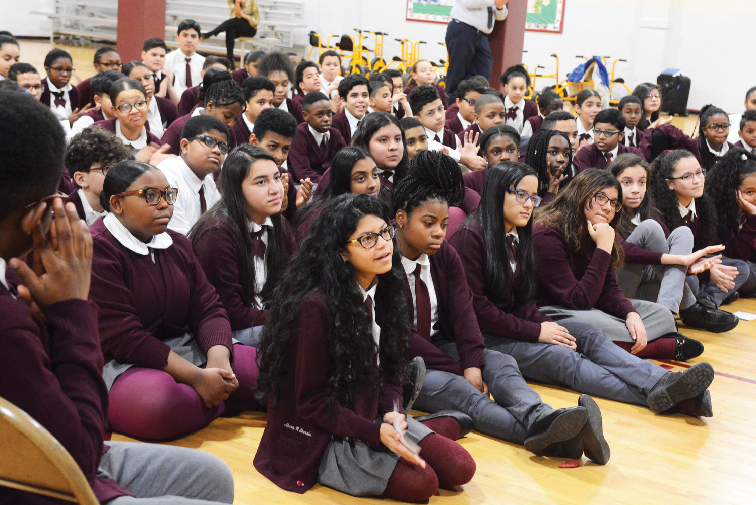 Sixth-, seventh- and eighth-grade students at St. Angela Merici School in the Bronx listen to a Career Day panel of judges, lawyers, court officers, court reporters, social workers and interpreters. The Bronx Catholic Guild and Bronx Women's Bar Association sponsored the Jan. 18 event.