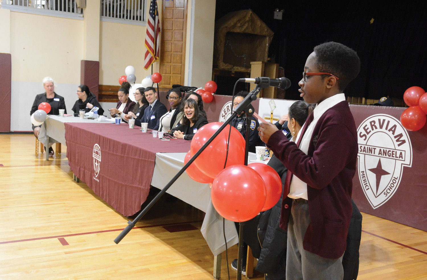 Eighth-grader Michael Adulley served as the student moderator.