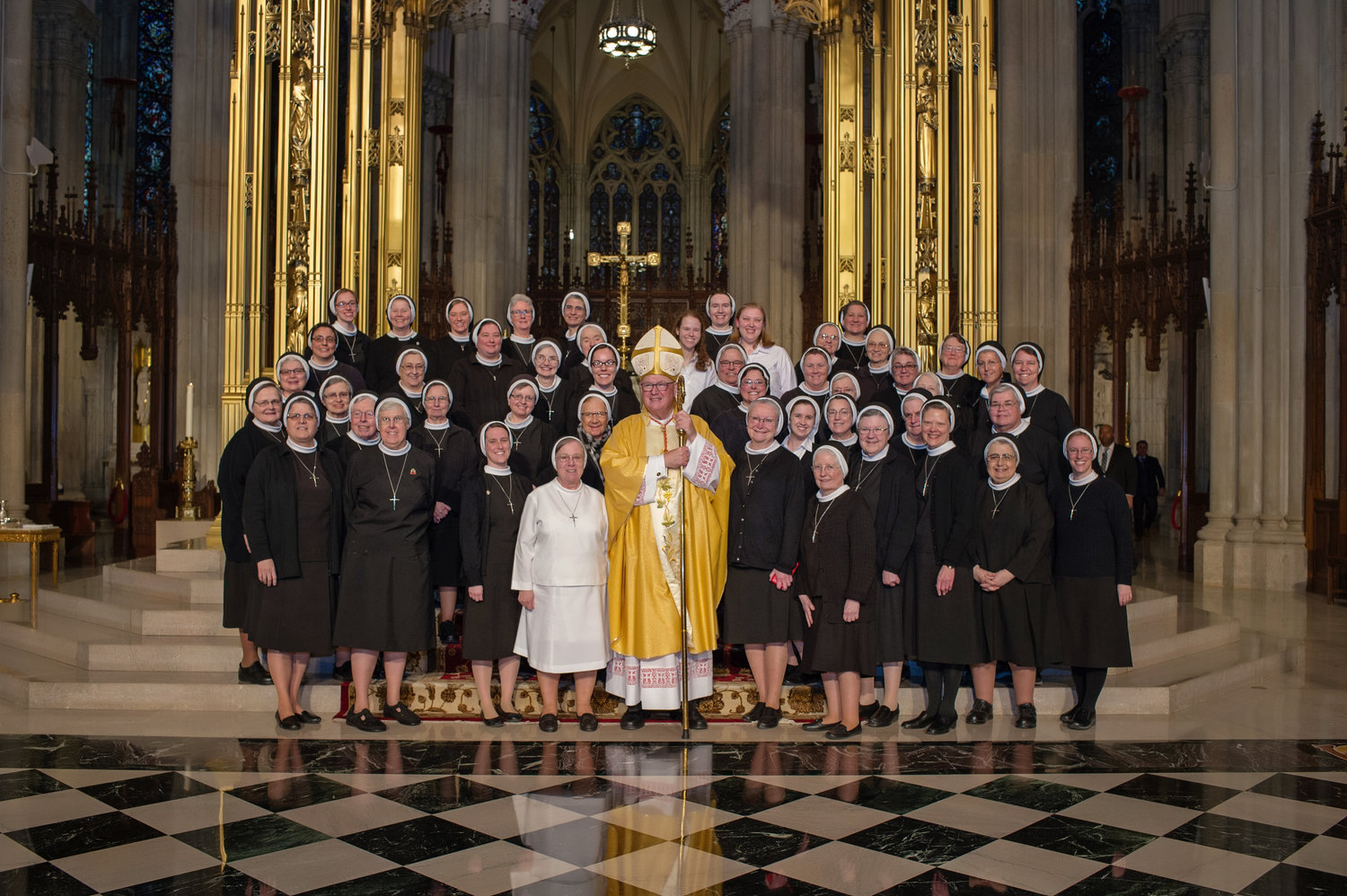 Apostles of the Sacred Heart of Jesus sisters who minister in New York and Connecticut gather with Cardinal Dolan at St. Patrick's Cathedral.