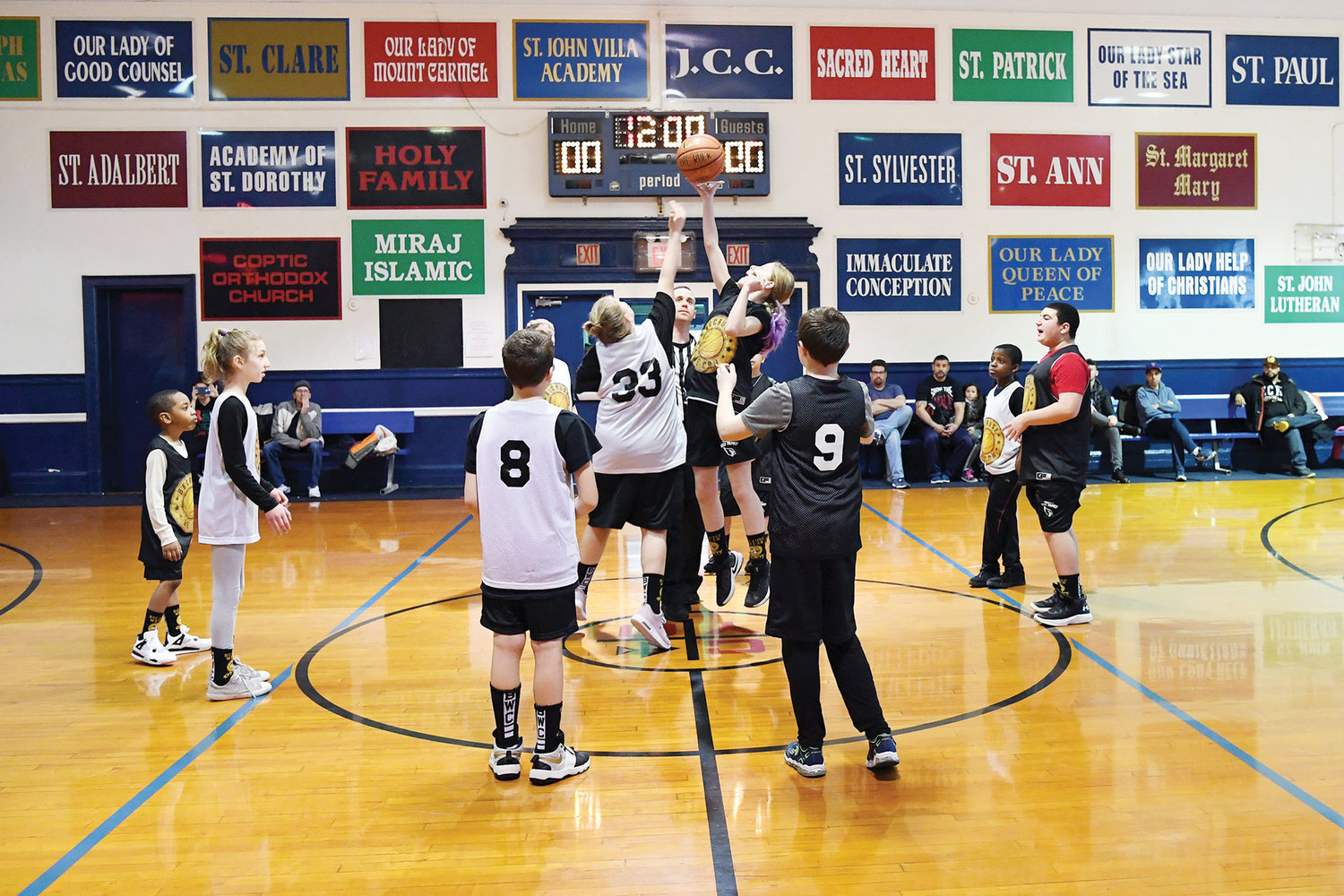 The Because We Can Sports basketball championship game begins with a jump ball at the CYO Center at Port Richmond on Staten Island Feb. 24. The game ended in a tie.