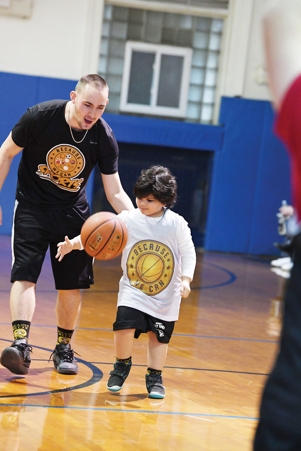 Sal Fabozzi, a head coach and founder of Because We Can Sports, instructs a player during the game.