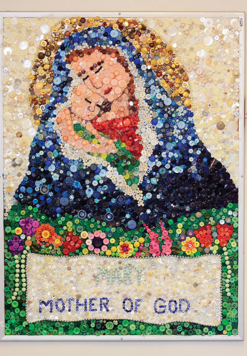 BEAUTY OF BUTTONS—About 2,500 buttons were used to create a colorful image of Madonna and Child at Holy Family School in New Rochelle.