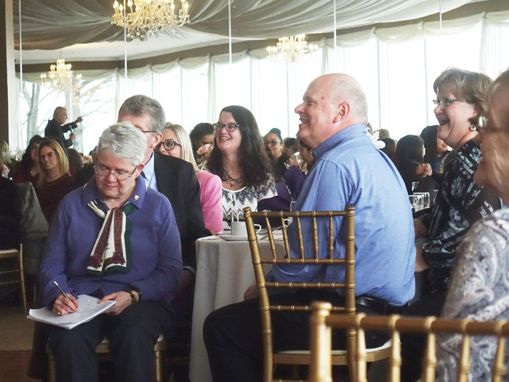 GOOD HUMOR—Above, catechists from the archdiocese enjoy Father Anthony Ciorra's keynote address at the annual Communion breakfast at The Riverview in Hastings-on-Hudson Feb. 23. Cardinal Dolan opened the day by offering Mass for the more than 220 catechists in attendance.
