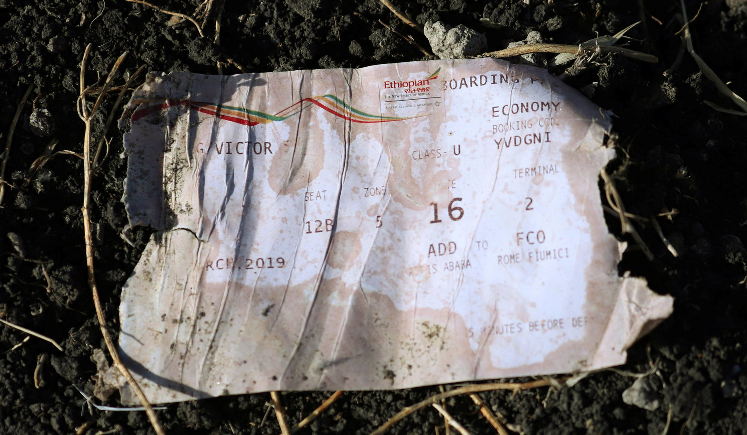 CRASH SITE—A boarding pass is seen at the scene of the Ethiopian Airlines Flight ET 302 plane crash March 11, near the town of Bishoftu, Ethiopia.