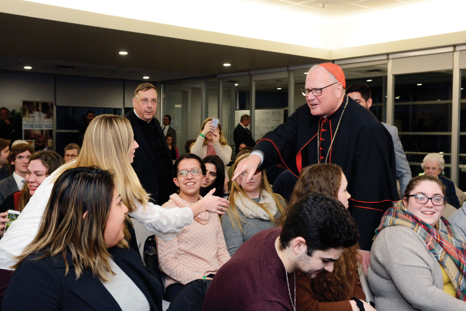 Cardinal Dolan greets college students at Rockland Community College's Student Union building in Suffern Feb. 28.