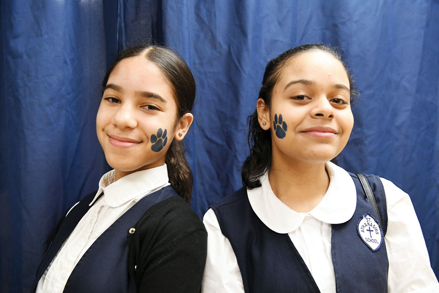 Jaelynn Rodriguez and Jennifer Moria sport bear claw face stickers representing the school mascot.