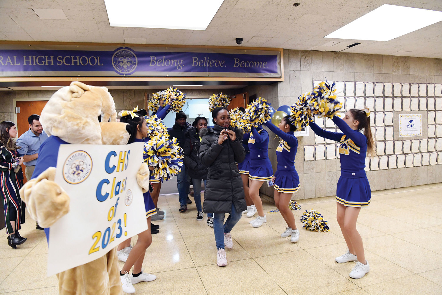 Ariana Arias leaves registration through the cheerleader line during High School Registration Day for Catholic high schools in the archdiocese at Cathedral High School in Manhattan March 7. Visiting eighth-graders were registering for the 2019-2020 academic year at Cathedral and received T-shirts and gifts from current students greeting them.