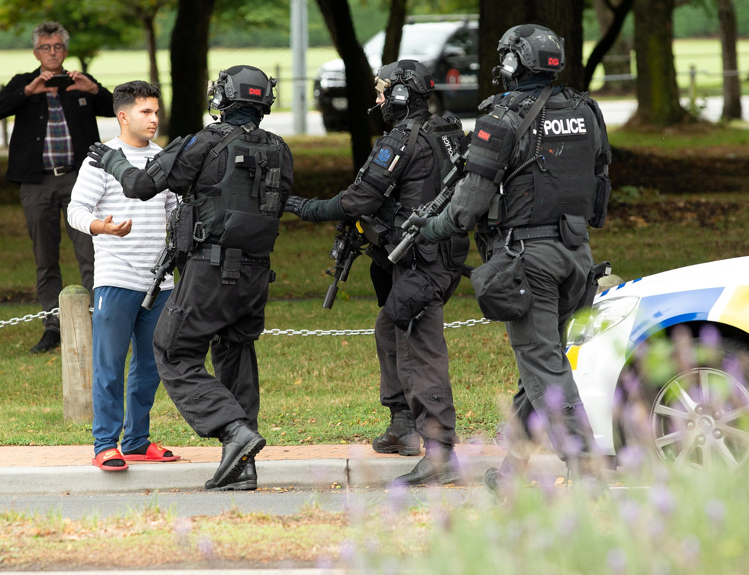 Members of a SWAT team push back members of the public following a shooting at the Al Noor Mosque in Christchurch, New Zealand, March 15.