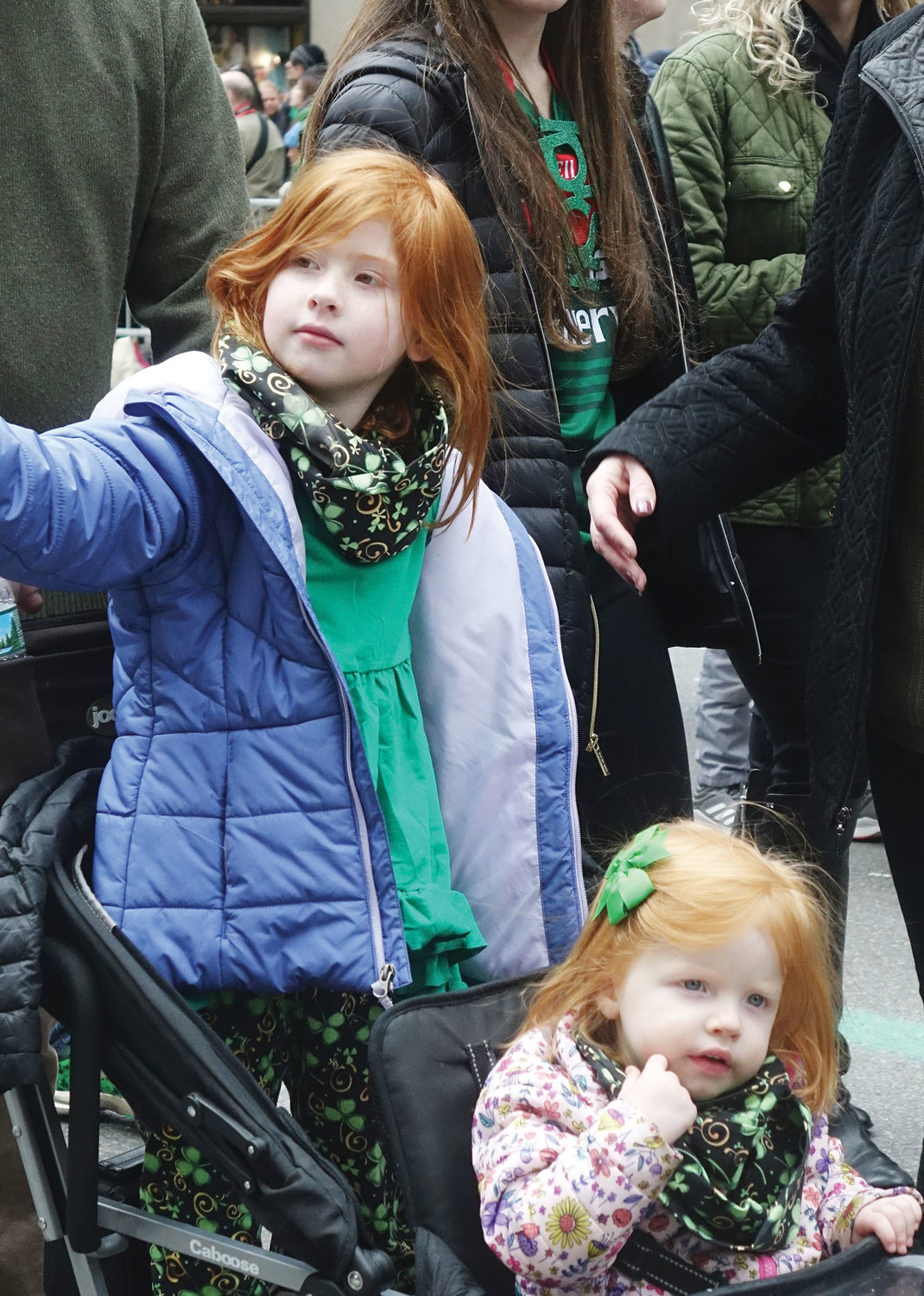 Two ginger-haired young girls enjoy the parade.