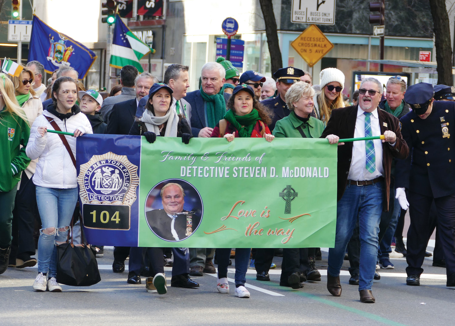Students from Manhattan College stride with smiles on their faces during the 258th New York City St. Patrick's Day Parade in Manhattan March 16.