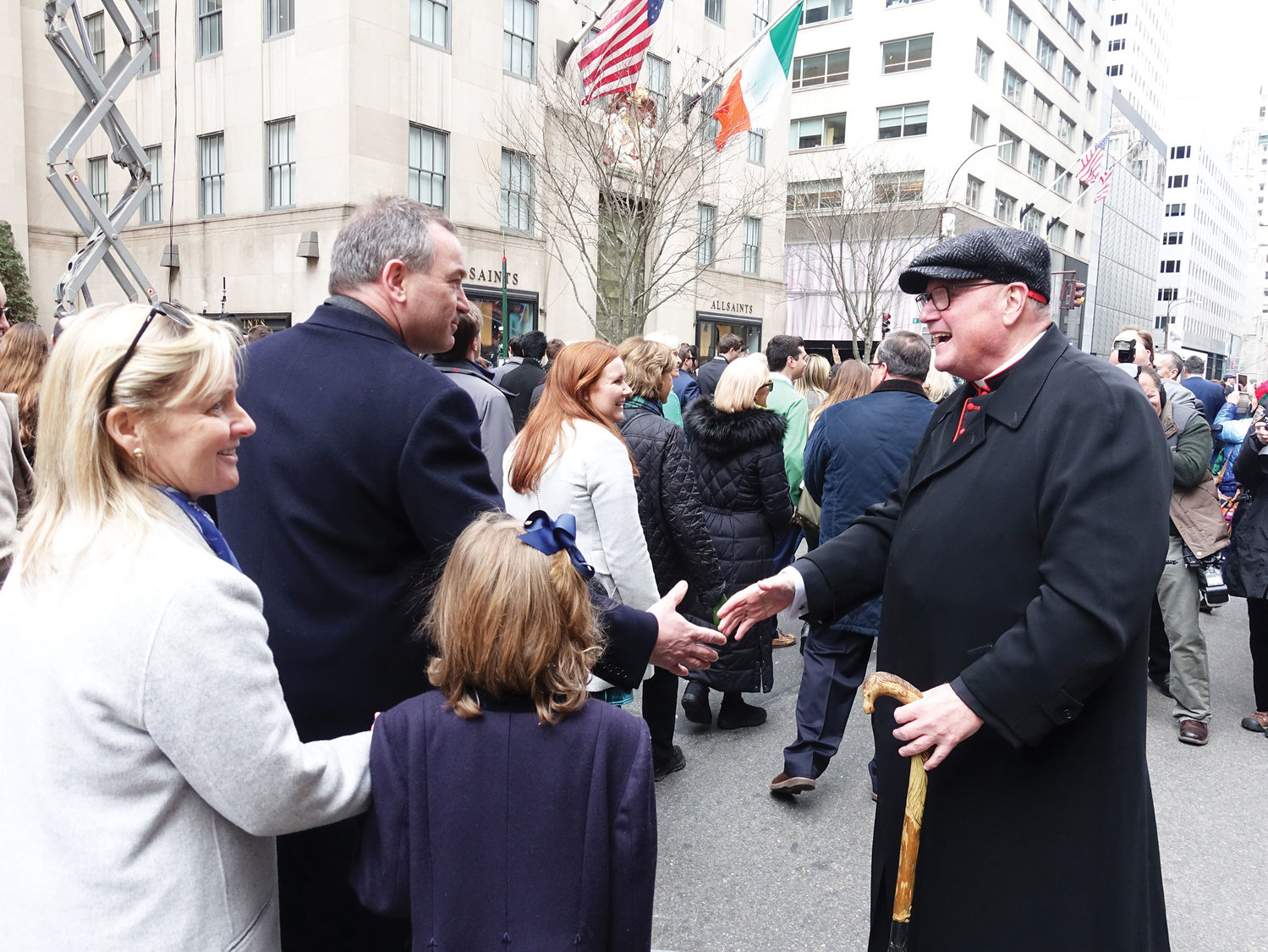 Cardinal Dolan greets marchers in front of St. Patrick's Cathedral.