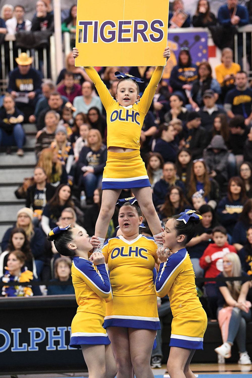 Our Lady Help of Christians cheerleaders lift their teammate in the Debs Small division.