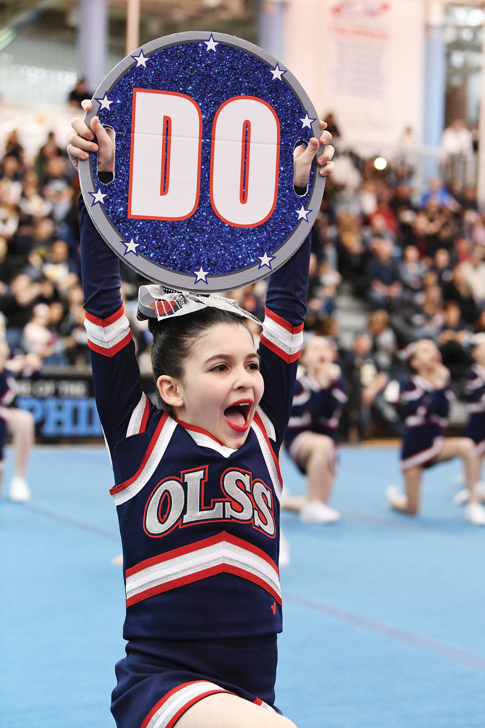 The girls from Our Lady Star of the Sea perform in the Debs Large division during the CYO New York archdiocesan cheerleading championships at the College of Staten Island March 23.