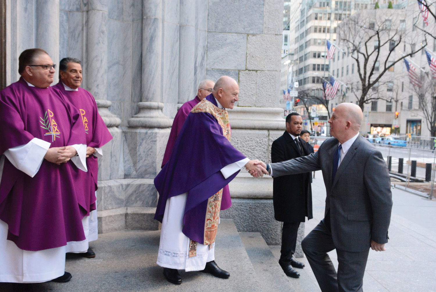 Msgr. Robert Ritchie, rector of St. Patrick's Cathedral and principal celebrant of the Mass, welcomes NYPD Commissioner James O'Neill to the cathedral.
