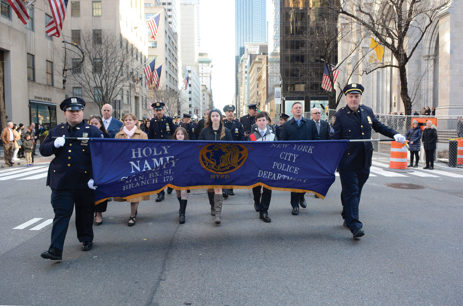 Members of the NYPD Holy Name Society march to the breakfast at the New York Hilton Hotel on 53rd Street and Avenue of the Americas.